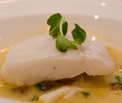 Maine Haddock Chowder with Potato Confit, Housemade Chouriço, and Saffron Cream
